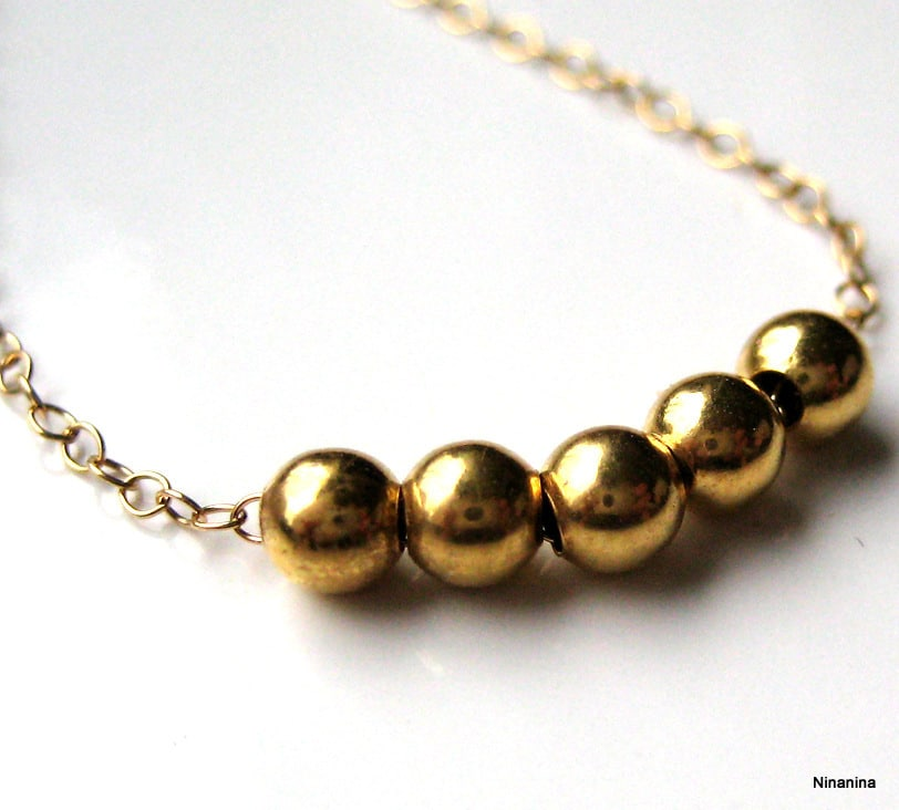 collier perle d'or
